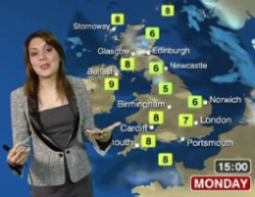 Laura Tobin with randomly chosen cities on a map