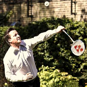 David Cameron playing badminton