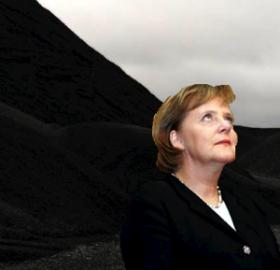 Angela Merkel beside a coal mountain