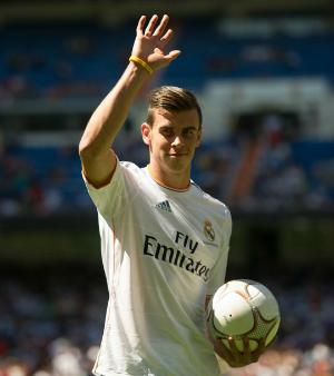 Gareth Bale holding a ball