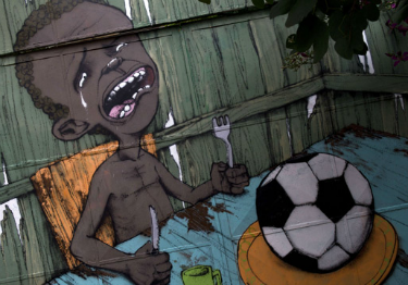 Graffiti showing a football served for dinner