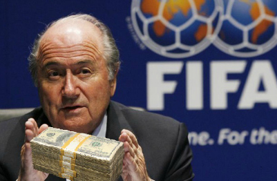 Sepp Blatter holds cash bundle
